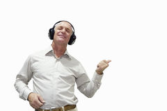 senior man dancing with earphones on, cut out Stock Images