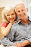 Senior man and daughter at home Royalty Free Stock Images