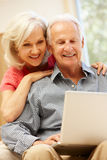 Senior man and daughter using laptop Stock Photos
