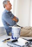 Senior man decorating house Stock Photos