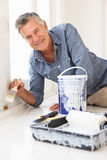 Senior man decorating house Royalty Free Stock Photo