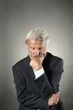 Senior man deeply focused and pensive Stock Images