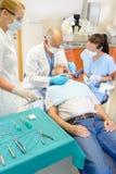 Senior man at dentist surgery have operation Royalty Free Stock Photography