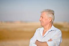 Senior man in desert Stock Photography