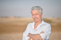 Senior man in desert Stock Image