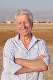 Senior man in desert Stock Photography