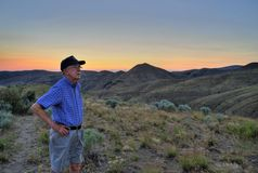 Senior man, desert sunset Stock Images