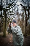 Senior man devoting time to his favorite hobby - photography royalty free stock images