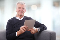 Senior man with digital tablet Stock Photography