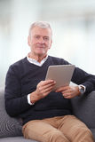 Senior man with digital tablet Royalty Free Stock Images