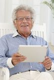 Senior man with digital tablet Royalty Free Stock Photography