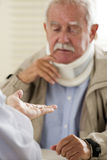 Senior man at the doctor Royalty Free Stock Photos