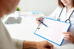 Senior man and doctor with cardiogram at hospital Stock Photography