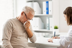 Senior man and doctor meeting at hospital Royalty Free Stock Photography