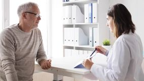 Senior man and doctor meeting at hospital 46 stock footage