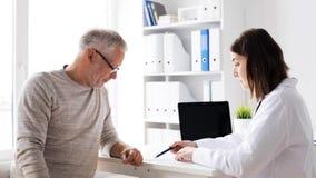Senior man and doctor meeting at hospital 60