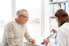 Senior man and doctor meeting at hospital Stock Photo
