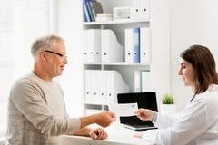 Senior man and doctor meeting at hospital Royalty Free Stock Photo