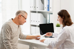 Senior man and doctor meeting at hospital Stock Image