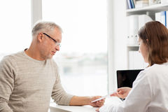 Senior man and doctor meeting at hospital royalty free stock photos