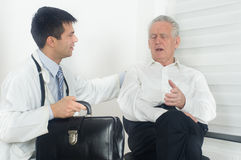 Senior man with doctor Stock Photos
