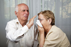 Senior man dodge sick women sneezing Royalty Free Stock Photography