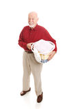 Senior Man Does the Laundry Stock Images