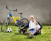 Senior man with dogs Stock Image