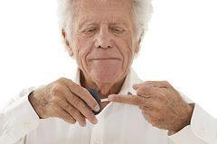 Senior man doing blood sugar test Stock Photo