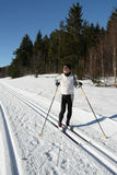 A senior man is doing cross-country skiing. In the forest region Stock Photos