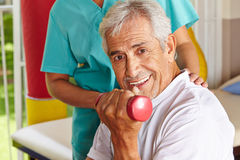 Senior man doing dumbbell training stock photo