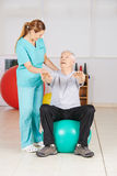 Senior man doing fitness exercise in physiotherapy Royalty Free Stock Photos