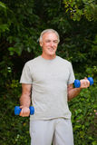 Senior man doing his exercises in the garden Royalty Free Stock Images