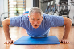 Senior Man Doing Press Ups Stock Photo
