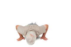 Senior man doing push ups Stock Image