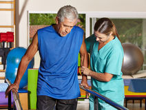 Senior man doing running training. Senior men doing running training with physiotherapist in nursing home Royalty Free Stock Image