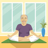 Senior man doing yoga exercises in lotus position sitting on mat Royalty Free Stock Photos