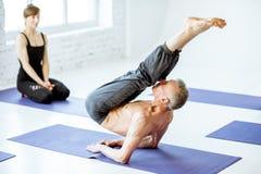 Senior man doing yoga indoors stock image