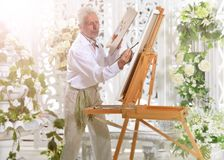 Senior man drawing picture Royalty Free Stock Photo