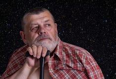 Senior man dreaming against star sky Royalty Free Stock Photos