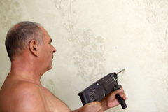 Senior man with a drill Royalty Free Stock Images
