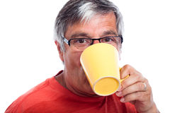 Senior man drinking Royalty Free Stock Image