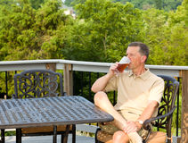 Senior man drinking beer in garden Royalty Free Stock Photo