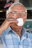 Senior man drinking coffee Stock Images