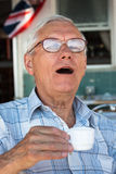 Senior man drinking coffee Stock Photos
