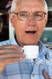 Senior man drinking coffee Stock Images