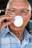 Senior man drinking coffee Royalty Free Stock Images