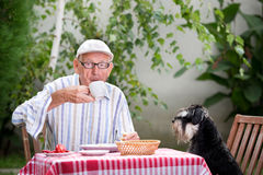 Senior man drinking coffee in garden Stock Photo