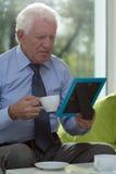 Senior man drinking coffee Royalty Free Stock Images