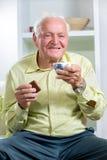 Senior man drinking coffee Stock Photography